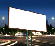 Blank billboard. Against blue sky, put your own text here stock images
