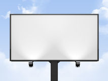 Blank Billboard. Large blank, empty, white billboard screen, on cloudy sky, for your advertisement and design royalty free stock photos