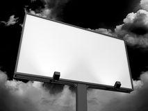 Blank Billboard. Large blank, empty, white billboard screen, on dark sky, for your advertisement and design Stock Photo
