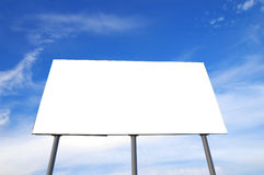 Blank billboard. And blue cloudy sky Stock Images