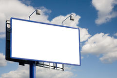 Blank billboard. A view of a blank highway billboard or road sign with open space for adding text or copy. Blue sky and cloud background royalty free stock photography