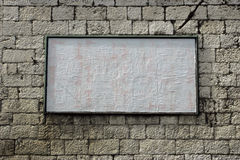 Blank billboard. Large white blank billboard on the stone wall stock photo