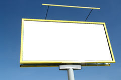 Blank billboard. Closeup of large blank billboard waiting for advertisement to be added - against clear blue sky stock image