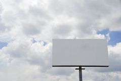 Blank Billboard. With clouded sky background Royalty Free Stock Photos