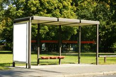 Blank Billboard. At bus stop in front of autumnly colored trees with lots of copy space royalty free stock images