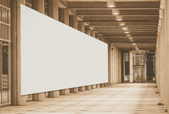 Blank billboard for advertise at building. Corridor Royalty Free Stock Image