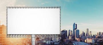 Blank billboard for advertisement at Bangkok city in sunrise Royalty Free Stock Photo