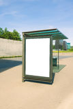 Blank billboard for advertisement, in a bus stop at the street. At sunny day Stock Photos