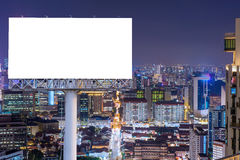 Blank billboard for advertisement in city downtown at night Stock Photo