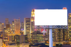 Blank billboard for advertisement in city downtown at night Royalty Free Stock Photos