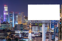 Blank billboard for advertisement in city downtown at night Royalty Free Stock Photo