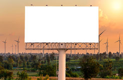Blank billboard for advertisement at Eco power in wind turbine f Stock Images