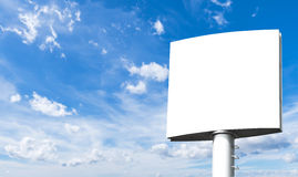 Blank billboard. For advertisement isolated on white fluffy clouds in the blue sky Royalty Free Stock Photo