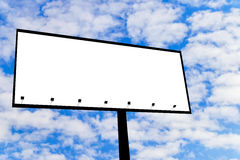 Blank billboard. For advertisement isolated on white fluffy clouds in the blue sky Royalty Free Stock Photography