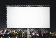 Blank billboard for advertisement on night sky in the city. Background Royalty Free Stock Images