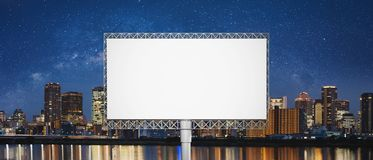 Blank billboard for advertisements, Night city with starry sky backgrounds stock image