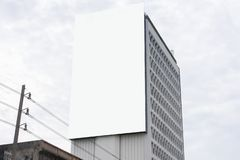 Blank billboard or advertising poster on the building wall mock up, for advertisement concept background.  royalty free stock image