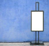 Blank billboard against blue concrete wall Stock Photo