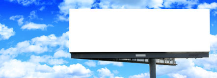 Blank billboard against blue sky Stock Photography