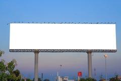 Blank billboard against blue sky Royalty Free Stock Photos