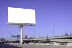 Blank billboard against blue sky for advertisement Royalty Free Stock Images
