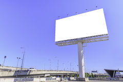 Blank billboard against blue sky for advertisement Stock Photos