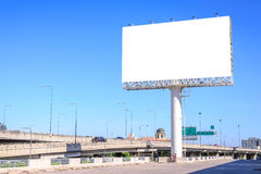 Blank billboard against blue sky for advertisement Royalty Free Stock Photo