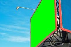 Blank billboard against blue sky. Stock Images