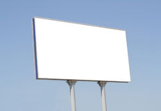 Blank billboard against blue sky with a place for Royalty Free Stock Photo