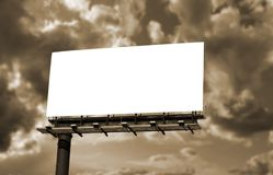 Blank billboard against the sky stock images