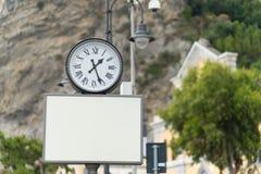 Blank billboard with analog clock Royalty Free Stock Image