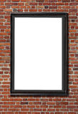 Blank billboard attached to a buildings red brick wall Royalty Free Stock Photos