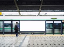 Blank Billboard Banner Light box in Subway station with people. Travel stock images