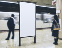 Blank Billboard Banner in Subway station with blurred people. Travel stock photography