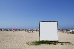Blank billboard in the beach Stock Images