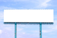 Blank billboard behind rusty roof of salt shed with blue sky for background Stock Photo
