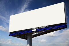 Blank billboard on a blue sky background. Royalty Free Stock Photos