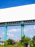 Blank billboard on blue sky Stock Photos