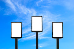 Blank billboard on blue sky with clouds. Stock Image