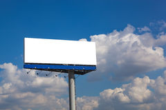 Blank billboard on blue sky with clouds Stock Image