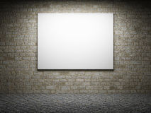 Blank billboard on a brick wall at night Royalty Free Stock Photo