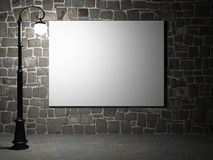 Blank billboard on a brick wall at night Royalty Free Stock Photography