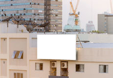 blank billboard on building in city view background Royalty Free Stock Photos