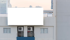 blank billboard on building in city view background Royalty Free Stock Photo