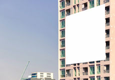 blank billboard on building in city view background Royalty Free Stock Images