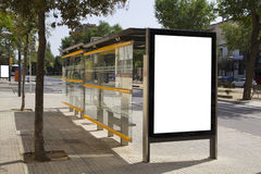 Blank billboard in a bus stop royalty free stock photography