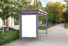 Blank billboard at bus stop Stock Photo