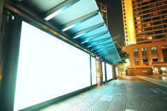Blank billboard on bus stop at night Stock Photo