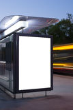 Blank billboard on bus stop. At night royalty free stock image