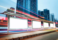 Blank billboard. On bus stop at night stock photography